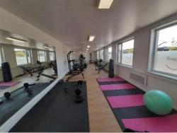 Maatwerkbedrijf OptimaT opent fitnesszaal voor werknemers